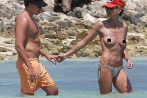 Heidi Klum sunbathing topless
