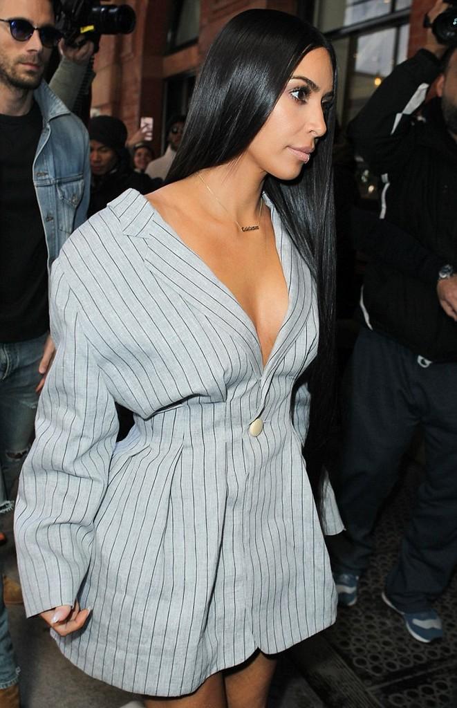 Kim Kardashian  Kim Kardashian Goes Bra Free In Sexy Minidress