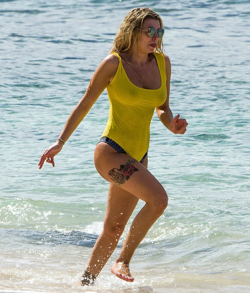Olivia Buckland Olivia Buckland In See Through Yellow Swimsuit (9 Pics)