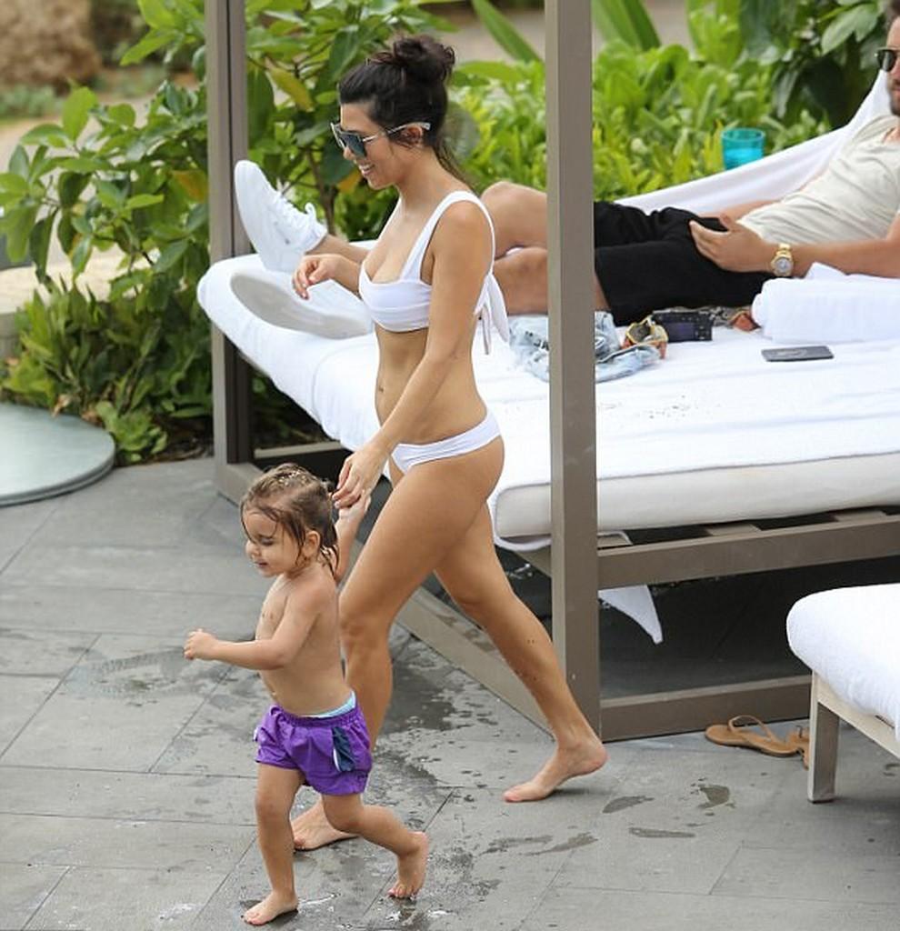Kourtney Kardashian in white bikini with kid Reign Kourtney Kardashian In White Swimsuit Bikini With Scott Disick (11 Pics)